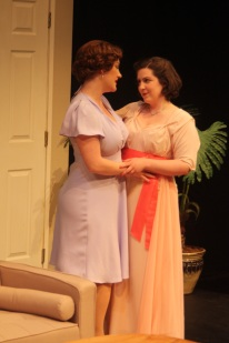 Image of Julia Beers and Zandi Carlson onstage in Perfect Arrangement.